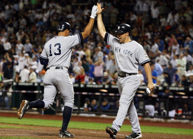 NEW YORK - JUNE 26:  Alex Rodriguez #13 of the New York Yankees celebrates his eighth-inning two-run home run against the New York Mets with teammate Mark Teixeira #25 on June 26, 2009 at Citi Field in the Flushing neighborhood of the Queens borough of Ne