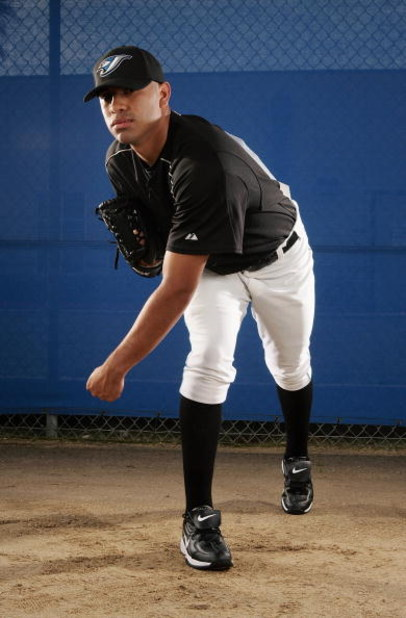 DUNEDIN, FL - FEBRUARY 25:  Ricky Romero of the Blue Jays poses for a portrait during the Toronto Blue Jays Photo Day at the Bobby Mattick Training Center on February 25, 2006 in Dunedin, Florida. (Photo by Nick Laham/Getty Images)