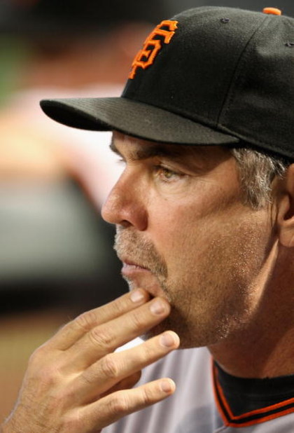 PHOENIX - JUNE 11:  Manager Bruce Bochy of the San Francisco Giants signals a play during the major league baseball game against the Arizona Diamondbacks at Chase Field on June 11, 2009 in Phoenix, Arizona.  (Photo by Christian Petersen/Getty Images)