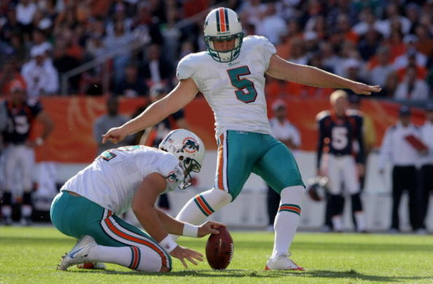 DENVER - NOVEMBER 02:  Place kicker Dan Carpenter #5 of the Miami Dolphins kicks a 45 yard field goal from the hold of Brandon Fields in the first quarter against the Denver Broncos during NFL action at Invesco Field at Mile High on November 2, 2008 in De
