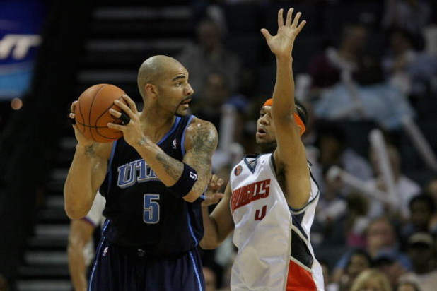 CHARLOTTE, NC - NOVEMBER 14:  Carlos Boozer #5 of the Utah Jazz looks for an open pass over Jared Dudley #4 of the Charlotte Bobcats during the game on November 14, 2008 at Time Warner Cable Arena in Charlotte, North Carolina.  The Bobcats won 104-96.  NO