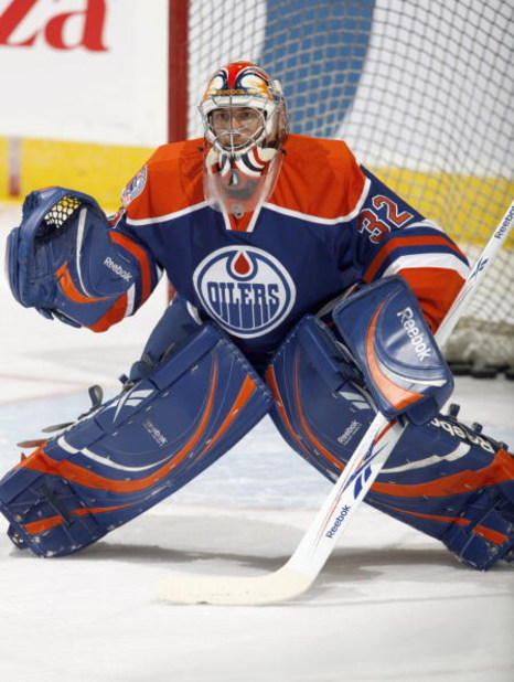 EDMONTON - OCTOBER 12:  Goalie Mathieu Garon #32 of the Edmonton Oilers guards the net during the game against the Colorado Avalanche on October 12, 2008 at Rexall Place in Edmonton, Alberta, Canada.  (Photo by Dale MacMillan/Getty Images)