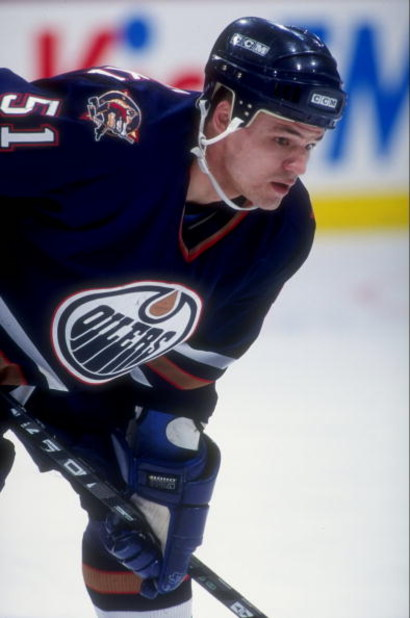 Oct 1996:  Andrei Kovalenko #51 of the Edmonton Oilers in action during a game against the Calgary Flames at the Canadien Airlines Saddledome in Calgary, Canada. Mandatory Credit: Ian Tomlinson  /Allsport