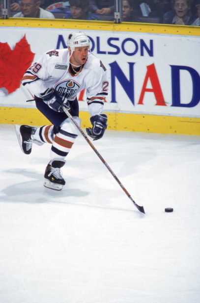 16 Apr 2000: Alexander Selivanov #29 of the Edmonton Oilers skating down the ice with the puck during the game against the Dallas Stars at the Skyreach Centre in Edmonton, Alberta, Canada. The Stars defeated the Oilers 5-2.