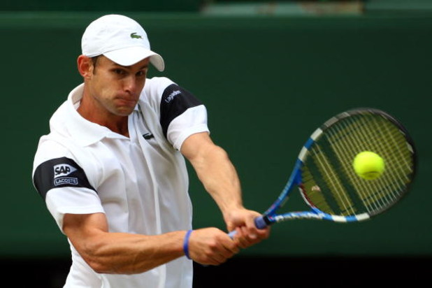 WIMBLEDON, ENGLAND - JULY 03:  Andy Roddick of USA plays a backhand during the men's singles semi final match against Andy Murray of Great Britain on Day Eleven of the Wimbledon Lawn Tennis Championships at the All England Lawn Tennis and Croquet Club on