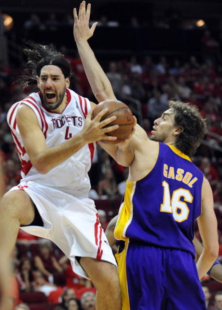 HOUSTON - MAY 14:  Forward Luis Scola #4 of the Houston Rockets drives the hoop against Pau Gasol #16 of the Los Angeles Lakers in Game Six of the Western Conference Semifinals during the 2009 NBA Playoffs at Toyota Center on May 14, 2009 in Houston, Texa