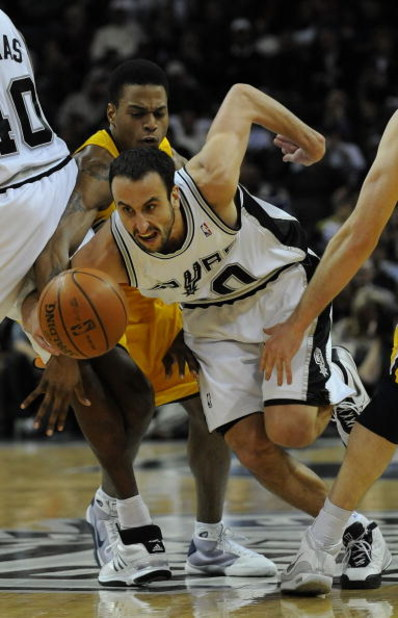 SAN ANTONIO - JANUARY 20:  Guard Manu Ginobili #20 of the San Antonio Spurs dribbles the ball past Brandon Rush #25 of the Indiana Pacers on January 20, 2009 at AT&T Center in San Antonio, Texas.  NOTE TO USER: User expressly acknowledges and agrees that,