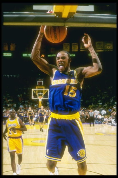 12 Mar 1997: Guard Latrell Sprewell of the Golden State Warriors slam dunks the ball during a game against the Los Angeles Lakers at the Great Western Forum in Inglewood, California. The Lakers won the game 109 - 101.