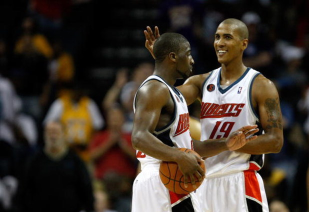 CHARLOTTE, NC - MARCH 31:  Teammates Raja Bell #19 and Raymond Felton #20 of the Charlotte Bobcats react after a play during their game against the Los Angeles Lakers at Time Warner Cable Arena on March 31, 2009 in Charlotte, North Carolina.  NOTE TO USER
