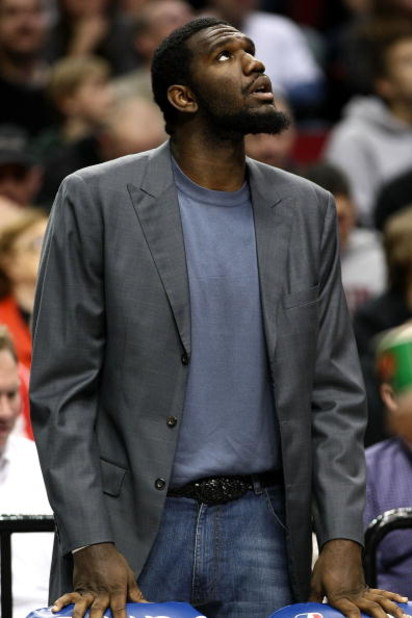 PORTLAND, OR - NOVEMBER 06:  Injured center Greg Oden of the Portland Trail Blazers  watches the game against the Houston Rockets at the Rose Garden on November 6, 2008 in Portland, Oregon.  NOTE TO USER: User expressly acknowledges and agrees that, by do