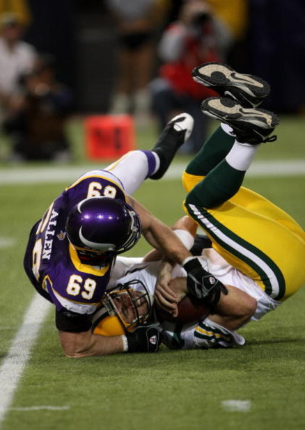 MINNEAPOLIS - NOVEMBER 09:  Defensive end Jared Allen #69 of the Minnesota Vikings sacks quarterback Aaron Rodgers #12 of the Green Bay Packers on November 9, 2008 at the Metrodome in Mineapolis, Minnesota.  (Photo by Stephen Dunn/Getty Images)