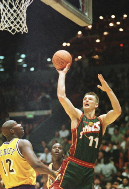 3 Dec 1996:  Detlef Schrempf #11 of the Seattle Supersonics goes up for a shot while Los Angeles Lakers forward Jerome Kersey #12 looks on during the first quarter at the Great Western Forum in Inglewood, California.  Mandatory Credit: Stephen Dunn/Allspo