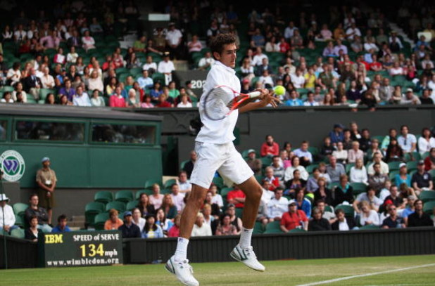 WIMBLEDON, ENGLAND - JUNE 24:  Marin Cilic of Croatia plays a forehand during the men's singles second round match against Sam Querrey of USA on Day Three of the Wimbledon Lawn Tennis Championships at the All England Lawn Tennis and Croquet Club on June 2