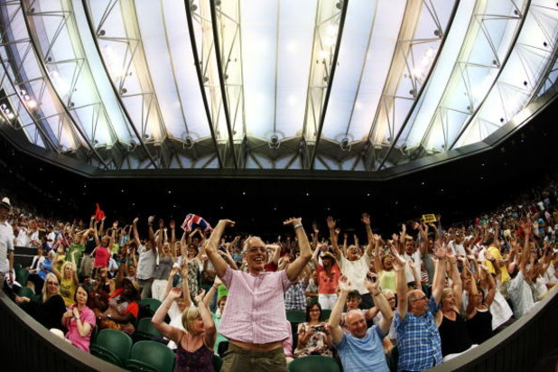 WIMBLEDON, ENGLAND - JUNE 29:  Spectators enjoy the atmosphere under the closed roof on Centre COurt as Andy Murray of Great Britain plays Stanislas Wawrinka of Switzerland during the men's singles fourth round matchon Day Seven of the Wimbledon Lawn Tenn