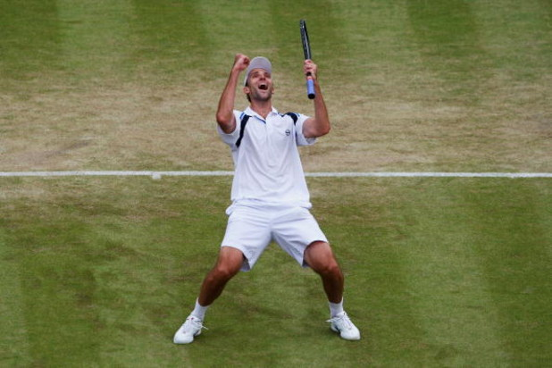 WIMBLEDON, ENGLAND - JUNE 26:  Ivo Karlovic of Croatia celebrates victory during the men's singles third round match against Jo-Wilfried Tsonga of France  on Day Five of the Wimbledon Lawn Tennis Championships at the All England Lawn Tennis and Croquet Cl