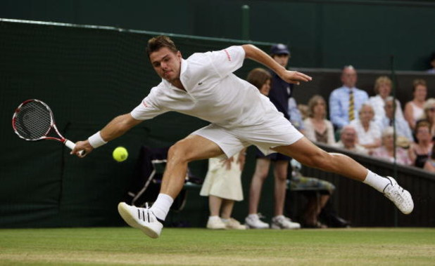 WIMBLEDON, ENGLAND - JUNE 29:  Stanislas Wawrinka of Switzerland plays a forehand during the men's singles fourth round match against Andy Murray of Great Britain on Day Seven of the Wimbledon Lawn Tennis Championships at the All England Lawn Tennis and C