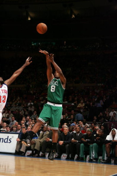 NEW YORK - MARCH 23:  Antoine Walker #8 of the Boston Celtics shoots over Malik Rose #13 of the New York Knicks during the game on March 23, 2005 at Madison Square Garden in New York City.  The Knicks won 107-82.  NOTE TO USER:  User expressly acknowledge
