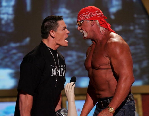UNIVERSAL CITY, CA - AUGUST 14:  Wrestlers John Cena and Hulk Hogan present an award onstage at the 2005 Teen Choice Awards held at Gibson Amphitheatre at Universal CityWalk on August 14, 2005 in Universal City, California.  (Photo by Kevin Winter/Getty I