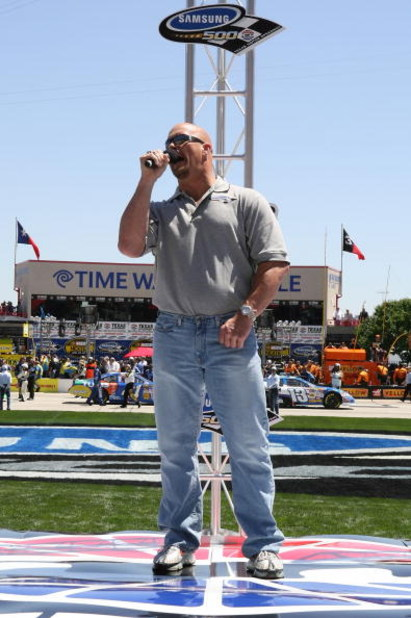 FORT WORTH, TX - APRIL 15: Honorary Starter, WWE wrestler 'Stone Cold' Steve Austin, gives the command for drivers to start their engines prior to the NASCAR Nextel Cup Series Samsung 500 at Texas Motor Speedway on April 15, 2007 in Fort Worth, Texas.  (P