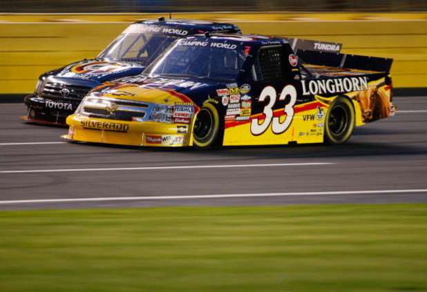 CONCORD, NC - MAY 15:  Ron Hornaday, Jr., driver of the #33 Longhorn Chevrolet, races Kyle Busch, driver of the #51 Miccosukee Resort Toyota during the NASCAR Camping World Series North Carolina Education Lottery 200 on May 15, 2009 at Lowe's Motor Speedw