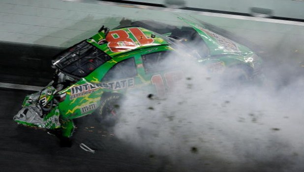 DAYTONA BEACH, FL - JULY 04:  Kyle Busch, driver of the #18 Interstate Batteries Toyota, crashes on the final lap during the NASCAR Sprint Cup Series 51st Annual Coke Zero 400 at Daytona International Speedway on July 4, 2009 in Daytona Beach, Florida.  (