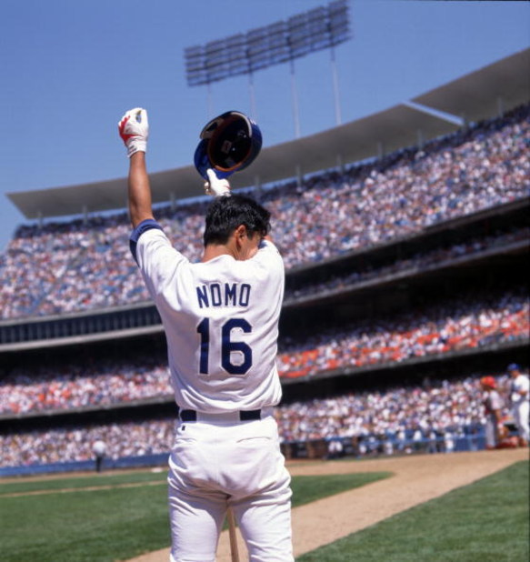 30 Jul 1995: Pitcher Hideo Nomo of the Los Angeles Dodgers wipes the sweat from his forehead while standing in the on deck circle waiting for his at-bat during the Dodgers 5-4 victory over the Cincinnati Reds at Dodger Stadium in Los Angeles, California.