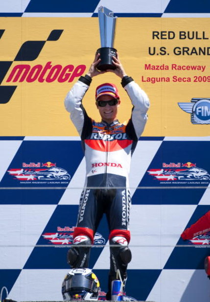 MONTEREY, CA - JULY 5:  Dani Pedrosa of Spain rider of the #3 Repsol Honda celebrates after winning the Moto GP Red Bull U. S. Grand Prix at the Mazda Raceway Laguna Seca on July 5, 2009 in Monterey, California.  (Photo by Robert Laberge/Getty Images)
