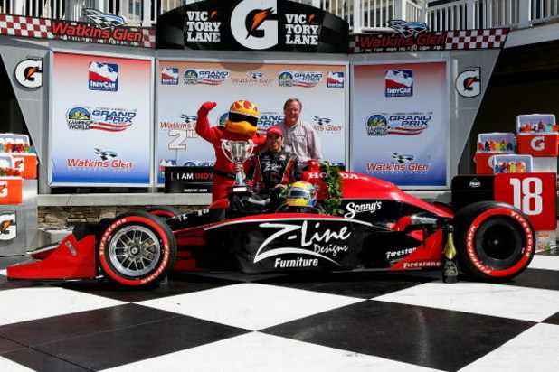 WATKINS GLEN, NY - JULY 05:  Justin Wilson driver of the #18 Z-Line Design Dale Coyne Racing Dallara Honda celebrates with his team owner Dale Coyne after the teams first ever victory at the IRL IndyCar Series Camping World Grand Prix at The Glen on July