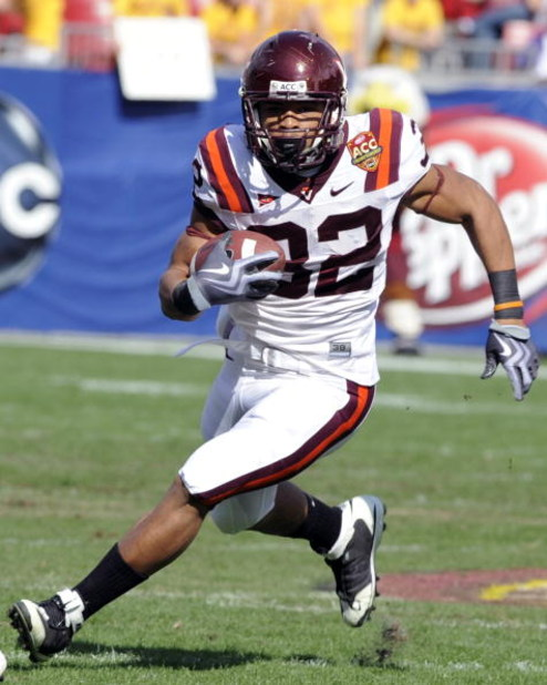 TAMPA, FL - DECEMBER 6: Running back Darren Evans #32 of the Virginia Tech Hokies rushes upfield against the Boston College Eagles in the 2008 ACC Football Championship game at Raymond James Stadium on December 6, 2008 in Tampa, Florida.  (Photo by Al Mes