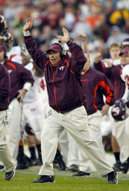 PHILADELPHIA - NOVEMBER 15:  Offensive coordinater Bryan Stinespring of the Virginia Tech Hokies celebrates during the game against the Temple Owls on November 15, 2003 at Lincoln Financial Field in Philadelphia, Pennsylvania. Virginia Tech defeated Templ