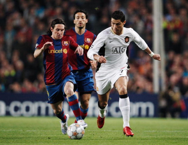 BARCELONA, SPAIN - APRIL 23:  Cristiano Ronaldo (R) of Manchester United holds off the challenge of Lionel Messi (L) of Barcelona during the UEFA Champions League Semi-Final, first leg match between Barcelona and Manchester United at the Camp Nou stadium