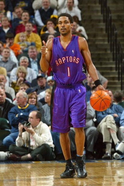INDIANAPOLIS - MARCH 9:  Rod Strickland #1 of the Toronto Raptors brings the ball upcourt during the game against the Indiana Pacers at Conseco Fieldhouse on March 9, 2004 in Indianapolis, Indiana.  The Raptors won 94-84.  NOTE TO USER: User expressly ack