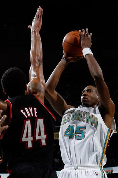 NEW ORLEANS - JANUARY 23:  Rasual Butler #45 of the New Orleans Hornets makes a shot over Channing Frye #44 of the Portland Trail Blazers on January 23, 2008 at the New Orleans Arena in New Orleans, Louisiana.  The Hornets defeated the Bucks 106-92.    NO