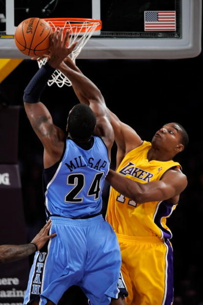 LOS ANGELES, CA - APRIL 27:  Andrew Bynum #17 of the Los Angeles Lakers blocks the shot of Paul Millsap #24 of the Utah Jazz in the second quarter of Game Five of the Western Conference Quarterfinals during the 2009 NBA Playoffs at Staples Center on April