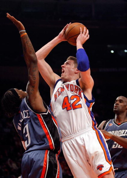 NEW YORK - MARCH 07:  David Lee #42 of the New York Knicks shoots the ball over Gerald Wallace #3 of the Charlotte Bobcats on March 7, 2009 at Madison Square Garden in New York City. NOTE TO USER: User expressly acknowledges and agrees that, by downloadin