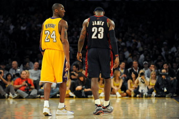 LOS ANGELES, CA - JANUARY 19:  Kobe Bryant #24 of the Los Angeles Lakers walks next to LeBron James #23 of the Cleveland Cavaliers during a break from the game at Staples Center on January 19, 2009 in Los Angeles, California.  (Photo by Harry How/Getty Im