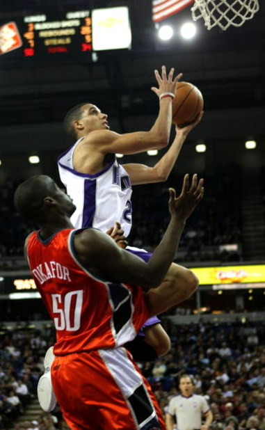 SACRAMENTO, CA - JANUARY 30:  Kevin Martin #23 of the Sacramento Kings shoots over Emeka Okafor #50 of the Charlotte Bobcats during an NBA game on January 30, 2008 at ARCO Arena in Sacramento, California. NOTE TO USER: User expressly acknowledges and agre