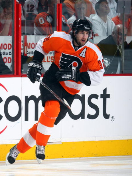 PHILADELPHIA - APRIL 21:  Simon Gagne #12 of the Philadelphia Flyers skates against the Pittsburgh Penguins during Game Four of the Eastern Conference Quarterfinal Round of the 2009 NHL Stanley Cup Playoffs  at the Wachovia Center on April 21, 2009 in Phi