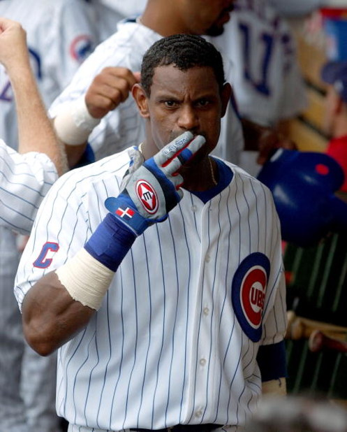 CHICAGO - AUGUST 26:  Sammy Sosa #21 of the Chicago Cubs blows kisses in the dugout after hitting a three-run home run in the third inning against the Houston Astros on August 26, 2004 at Wrigley Field in Chicago, Illinois. The Cubs defeated the Astros 8-