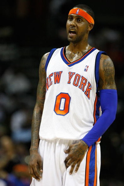 CHARLOTTE, NC - MARCH 28:  Larry Hughes #0 of the New York Knicks yells to a teammate during their game against the Charlotte Bobcats at Time Warner Cable Arena on March 28, 2009 in Charlotte, North Carolina.  NOTE TO USER: User expressly acknowledges and