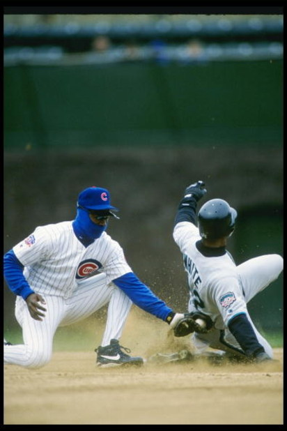 10 Apr 1997: Shawon Dunston (left) of the Chicago Cubs tags runner Deion White of the Florida Marlins during the Cubs 1-0 loss at Wrigley Field in Chicago, Illinois.