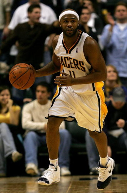 INDIANAPOLIS - NOVEMBER 23:  Jamaal Tinsley #11 of the Indiana Pacers brings the ball down court against the Dallas Mavericks at Conseco Fieldhouse November 23, 2007 in Indianapolis, Indiana.  (Photo by Matthew Stockman/Getty Images)