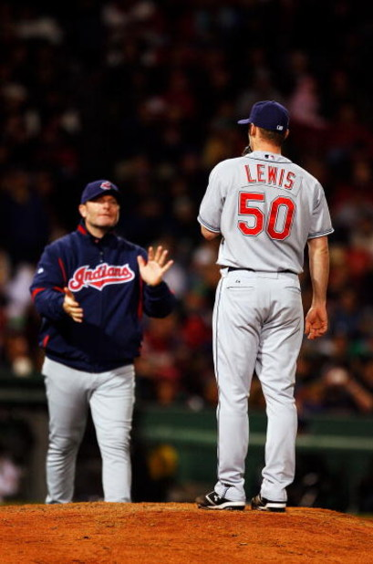 BOSTON - OCTOBER 13:  Jensen Lewis #50 of the Cleveland Indians stands on the mound as manager Eric Wedge walks in to pull him from the game in the seventh inning against the Boston Red Sox during Game Two of the American League Championship Series at Fen