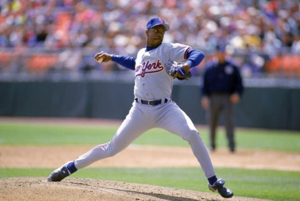DENVER - APRIL 15:  Dwight Gooden #16 of the New York Mets winds up for a pitch during a game against the Colorado Rockies at Coors Field on April 15, 1993 in Denver, Colorado.  (Photo by Tim DeFrisco/Getty Images)
