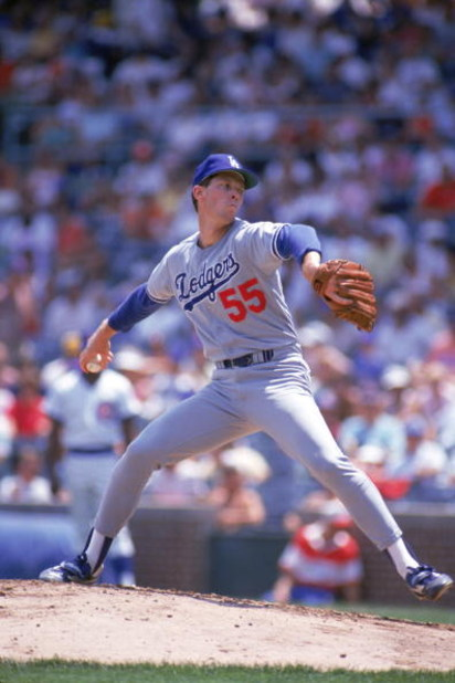 CHICAGO - 1987:  Orel Hershiser #55 of the Los Angeles Dodgers pitches against the Chicago Cubs in the 1987 season at Wrigley Field in Chicago, Illinois.  (Photo by Jonathan Daniel/Getty Images)