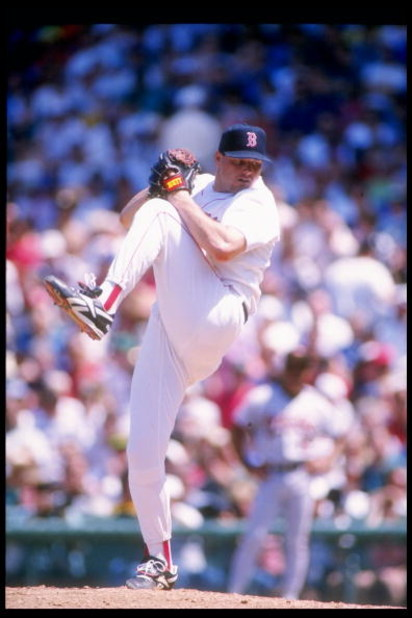 13 Jun 1993: Pitcher Roger Clemens of the Boston Red Sox winds up for the pitch during a game against the Baltimore Orioles at Fenway Park in Boston, Massachusetts.