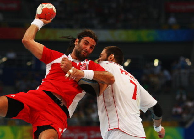 BEIJING - AUGUST 24:  Ivano Balic of Croatia competes with Carlos Prieto of Spain during the Men's Handball Bronze Medal Match between Croatia and Spain held at the National Indoor Stadium during Day 16 of the Beijing 2008 Olympic Games on August 24, 2008