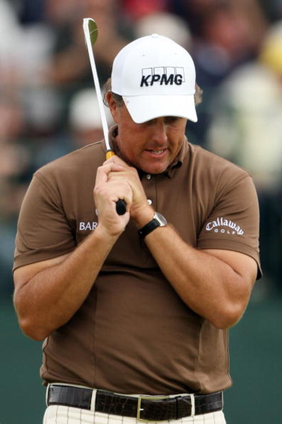 FARMINGDALE, NY - JUNE 22:  Phil Mickelson reacts to a missed putt on the 18th green during the continuation of the final round of the 109th U.S. Open on the Black Course at Bethpage State Park on June 22, 2009 in Farmingdale, New York.  (Photo by Andrew
