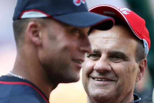 ST LOUIS, MO - JULY 13:  National League All-Star manager Joe Torre of the Los Angeles Dodgers and American League All-Star Derek Jeter of the New York Yankees stand on the field during the Gatorade All-Star Workout Day at Busch Stadium on July 13, 2009 i