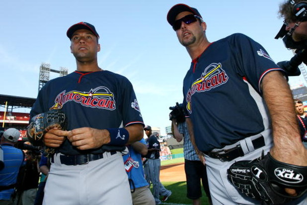 ST LOUIS, MO - JULY 13:  American League All-Stars Derek Jeter of the New York Yankees and Tim Wakefield of the Boston Red Soxs stand on the field during the Gatorade All-Star Workout Day at Busch Stadium on July 13, 2009 in St Louis, Missouri.  (Photo by